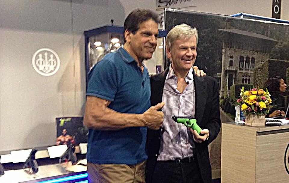 "Franco Gussalli Beretta, right, presenting Lou Ferrigno with the ""Hulk"" themed Beretta PX4 Storm pistol. (Photo: Beretta)"