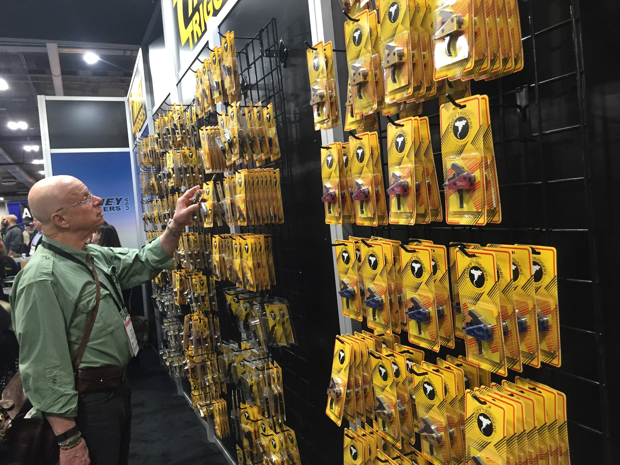 A man peruses triggers at SHOT Show 2017 in Las Vegas, Nevada, on Wednesday.