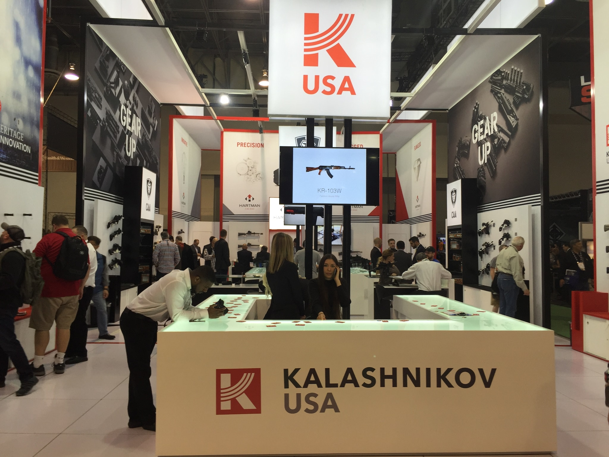 Kalashnikov USA's booth, elegant like a ballistic version of the Cartier store down the street.