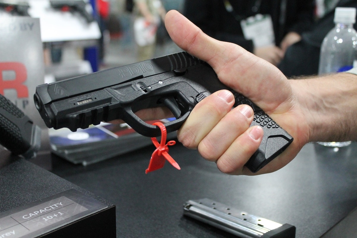 A SHOT Show exhibitor breaks away from his booth to check out the PD10. (Photo: Jacki Billings)