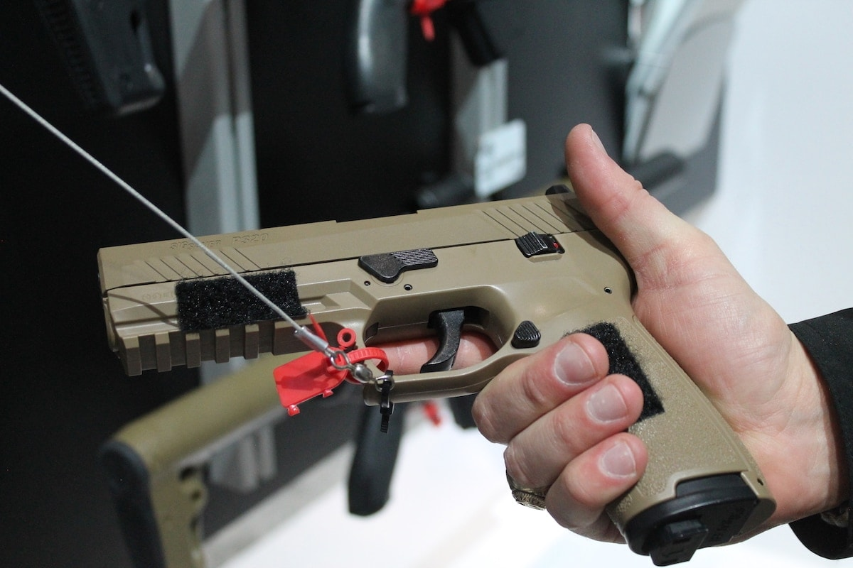 Actual P320 ASPs will not come with velcro on the slide. This display model, however, had to adhere to the wall in some manner. (Photo: Jacki Billings)