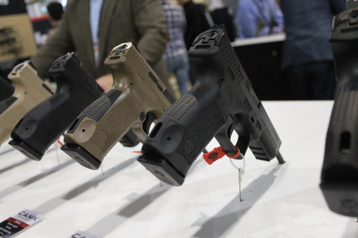 A row of Canik TP9S models in black and flat dark earth. (Photo: Jacki Billings)