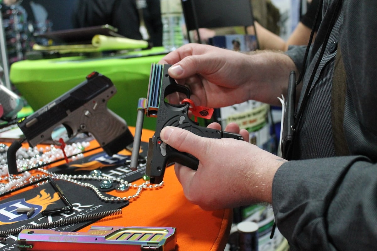 A SHOT Show attendee breaks down the PKO 9mm version for a better look at its inner workings. (Photo: Jacki Billings)