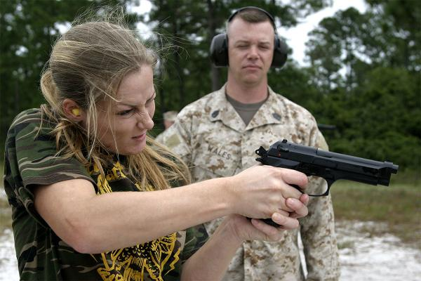 A Marine spouse shoots at a target with a M9 9mm pistol. (Photo: U.S. Marine Corps)