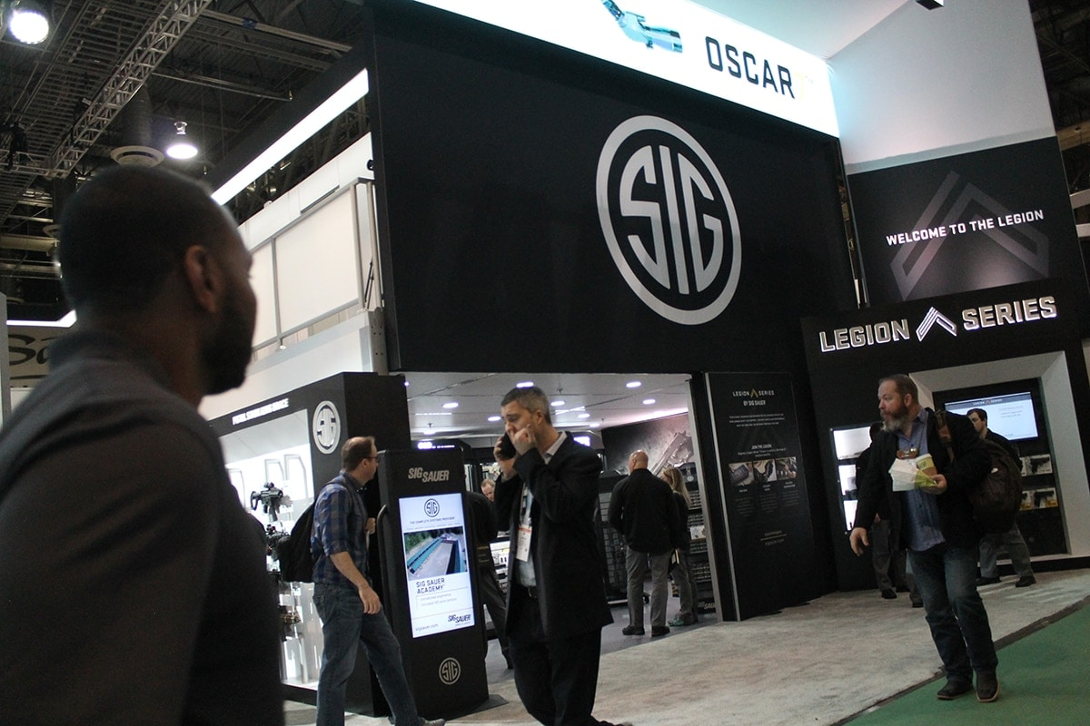 Sig's booth was packed with dealers and media wanting to catch a sneak peek at the newest models of pistols, rifles and optics. (Photo: Jacki Billings)