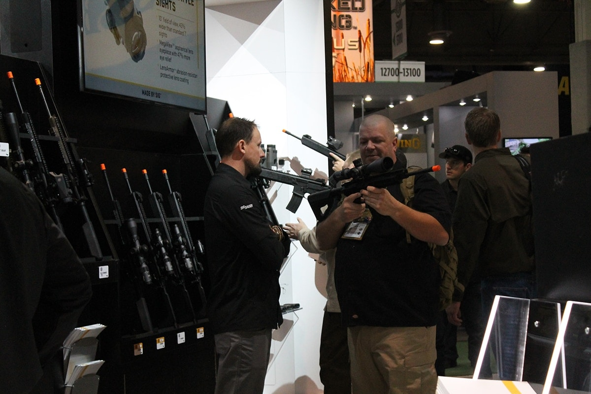 A SHOT Show attendee checking out Sig's air soft rifle selection. (Photo: Jacki Billings)