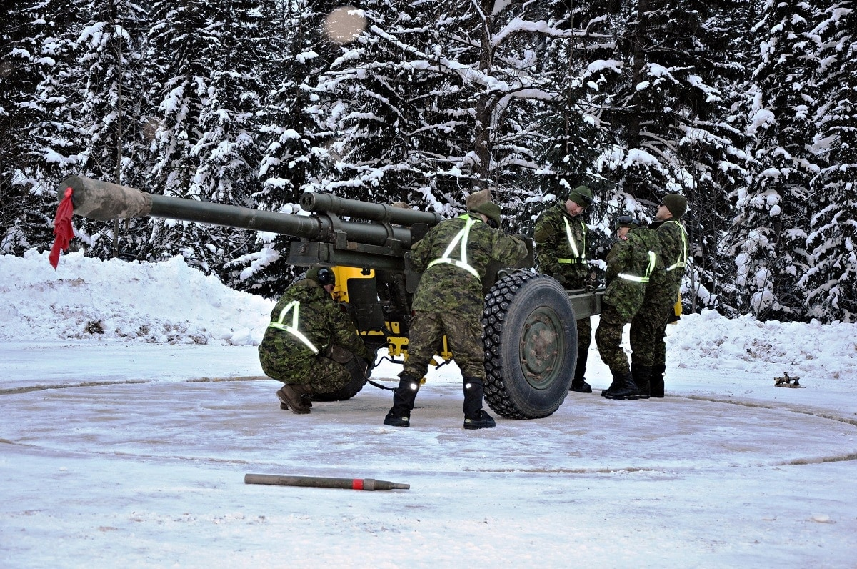Troops from 1st Regiment, Royal Canadian Horse Artillery move the 105-mm C3 Howitzer gun in preparation for firing at Rogers Pass (2)