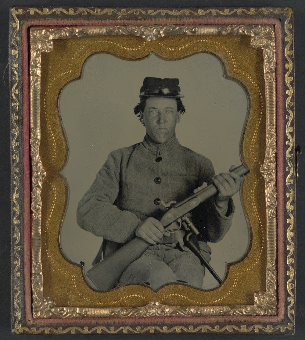 Unidentified soldier in Confederate uniform with Enfield rifle (Photo: Library of Congress.)