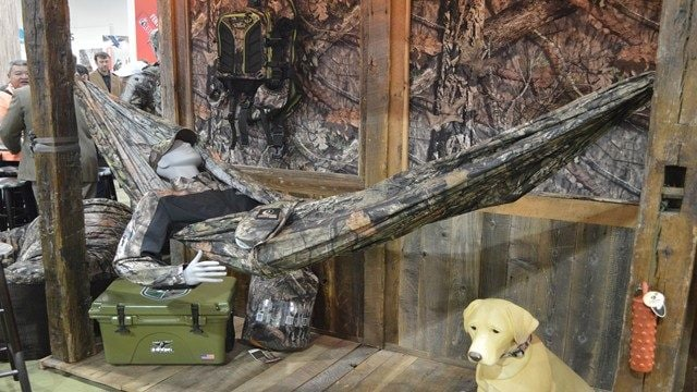 Realtree brands displayed a host of licensed products, including this Realtree camo-clad hunter in his packable camo hammock. (Photo: Kristin Alberts)