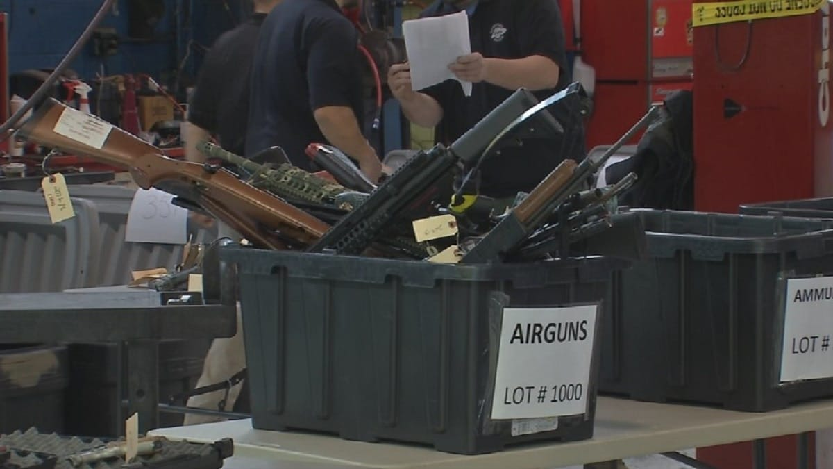 Bins of guns up for sale at a Kentucky State Police auction (Photo: WDRB)