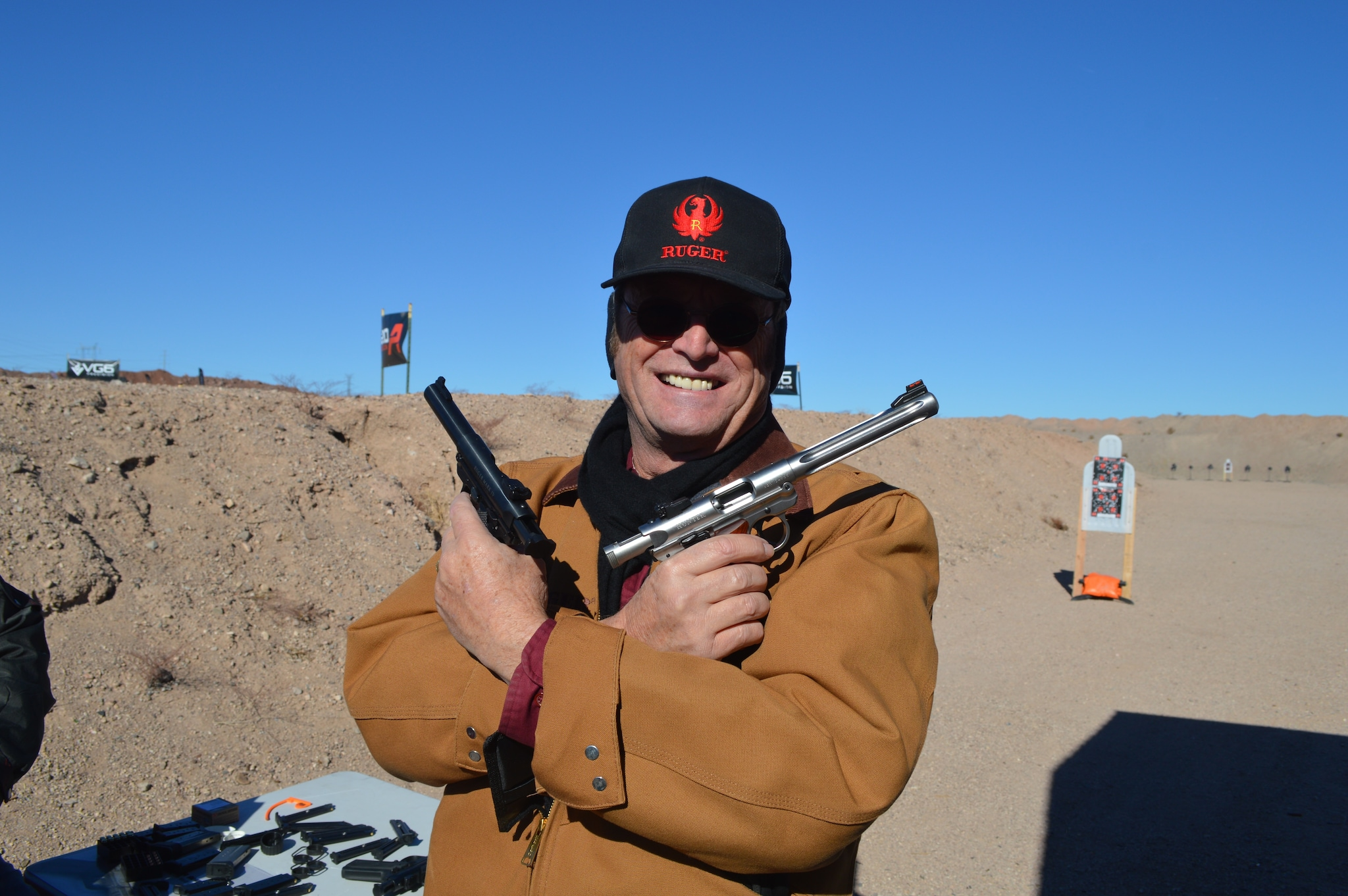Dave Anderson, designer and mastermind behind Ruger's new Mark IV pistols, shows off a pair of his favorite models. (Photo: Kristin Alberts)
