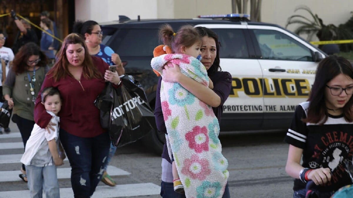 Police escort shoppers out of San Antonio shopping mall after fatal shooting (Photo: AP)