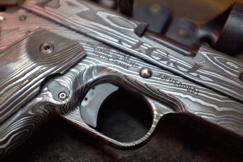 Though the pistol is forged from steel, it is engraved to look wood-like. (Photo: JJFU)
