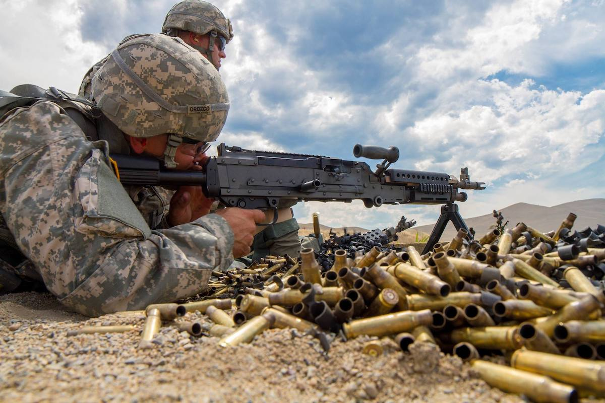 Caption: An Army Soldier fires a M-240 machine gun, chambered in 7.62, during the U.S. Army Reserve's Best Warrior competition at Fort Harrison, Montana. (Photo: Calvin Reimold)