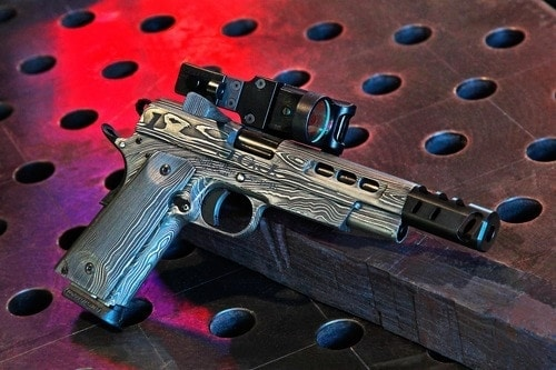 The Damascus Cisco 1911 features an ornately designed body as well as perks like a side mounted red dot sight and compensator. (Photo: JJFU)