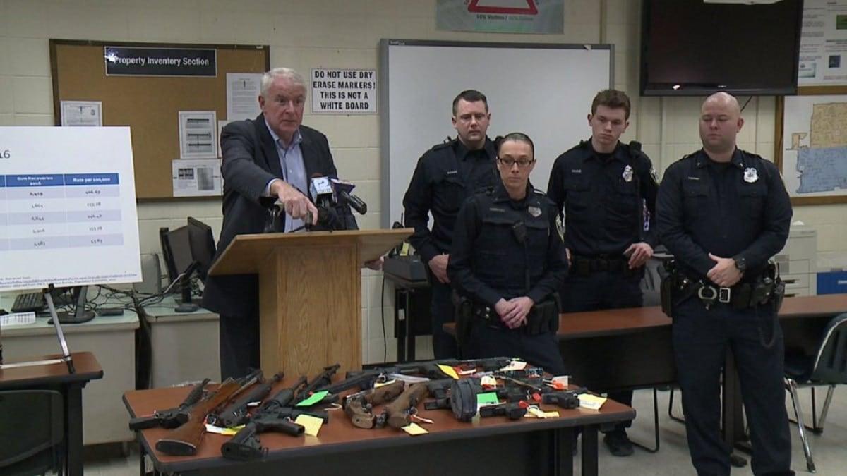 Milwaukee Mayor Tom Barrett points to several firearms seized by Milwaukee police in 2017 (Photo: Fox 6 News)