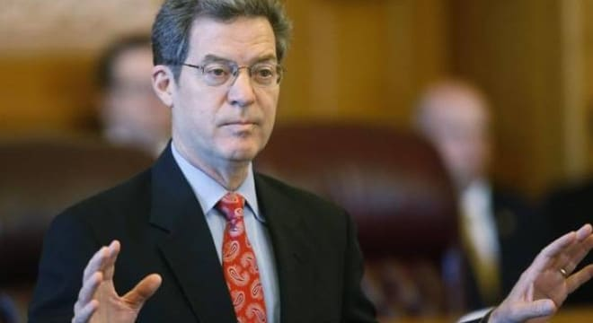 Gov. Sam Brownback signed the Kansas Second Amendment Protection Act into law in 2013 but state Attorney General Derek Schmidt was quick to point out it did not include NFA items (Photo: Bo Reader/AP)