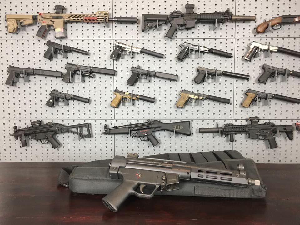 A sampling of various items currently regulated under the National Firearms Act including suppressors, select-fire guns, SBRs, and SBSs-- oh my. (Photo: NFA Review Channel)
