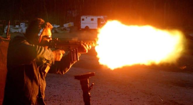 A participant enjoys the Knob Creek Shooting Range's machine gun shoot. (Photo: Knob Creek)