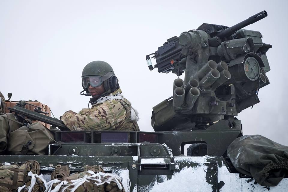 Mk19 40mm Grenade launcher cooling its heels next to a brace of smoke grenade launchers