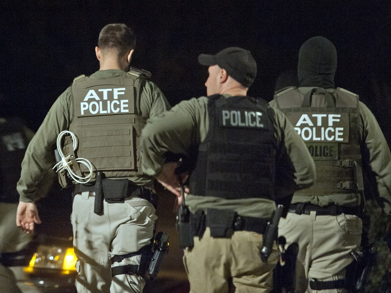 Authorities from the Bureau of Alcohol, Tobacco, Firearms and Explosives search a defendant's home (Photo: Getty Images)