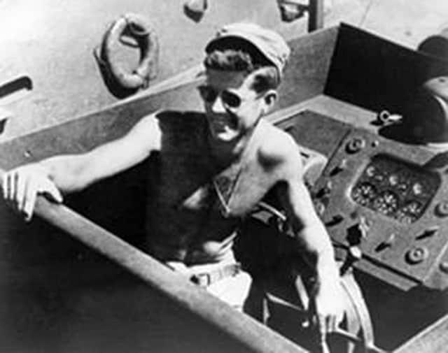 JFK shirtless on a battleship