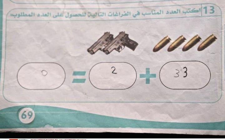 Example of a math problem found in an ISIS school textbook (Photo: REX via The Telegraph)