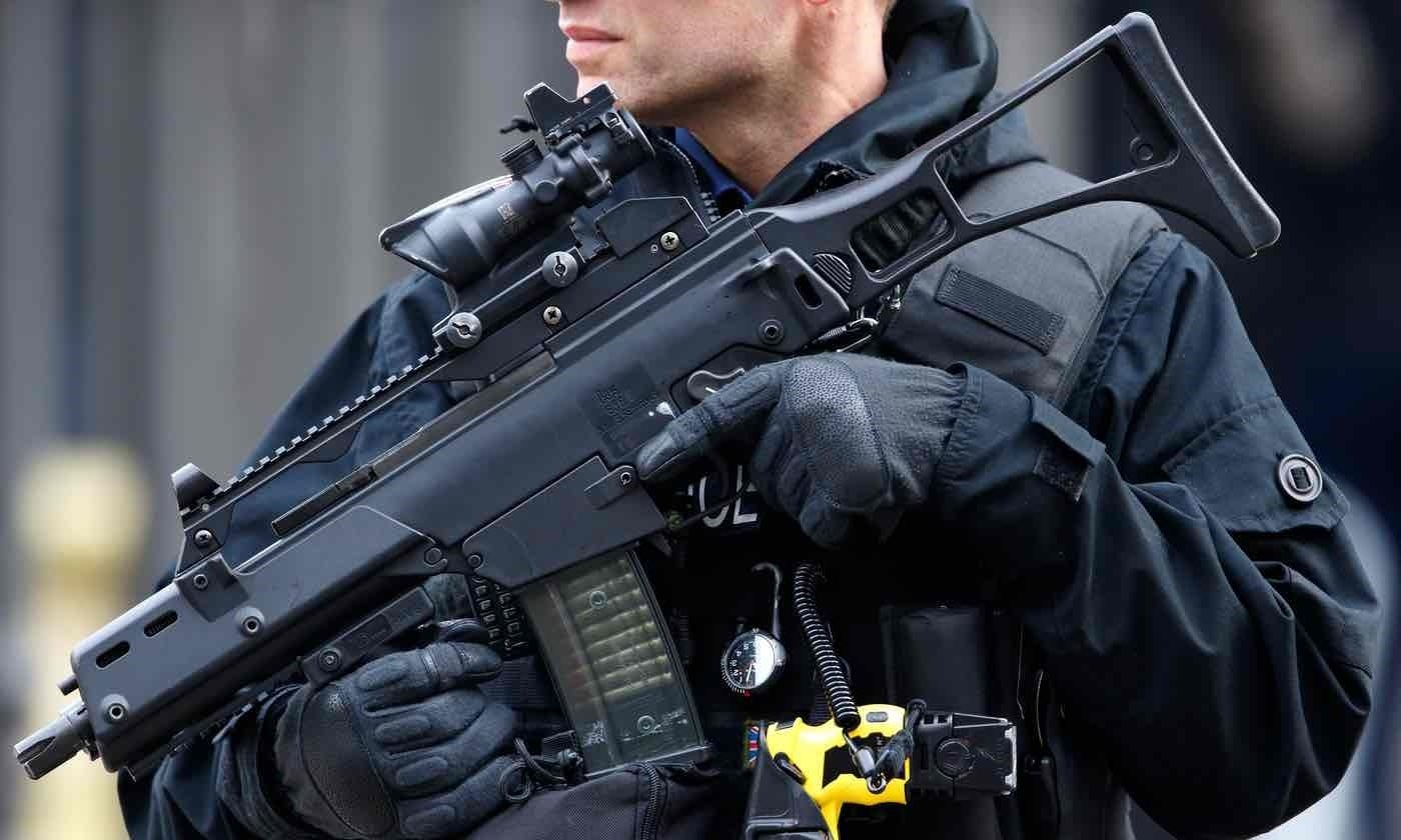 A City of London officer holds an assault rifle, also armed with a Taser and handgun. (Photo: Getty)