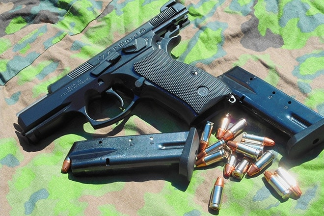 cz75 p01 omega with magazines and ammo on camo cloth
