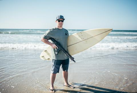 Alex West, founder of One More Wave, with the Gen III OMW rifle. West's organization provides surfboards for disabled vets. (Photo: Noveske Rifleworks)