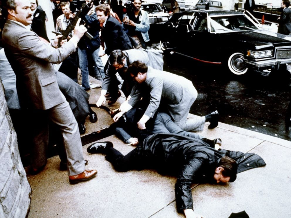 This photo taken by presidential photographer Mike Evens on March 30, 1981 shows police and Secret Service agents reacting during the assassination attempt on then US president Ronald Reagan, after a conference in Washington, D.C. (Photo: Mike Evens/Getty Images)