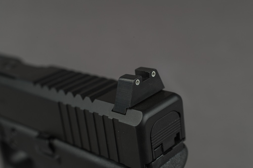 Trijicon suppressor sights fore and aft help keep the user on target even in the quietest of conditions
