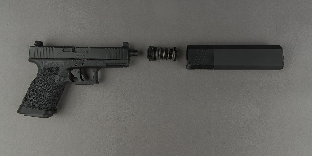 SilencerCo's threaded barrel and black nitrided piston are at work behind the scenes for the can-to-Glock interface