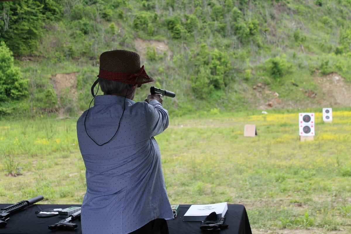 A woman takes aim at a target during a shooting event hosted during the National Rifle Association's Annual Meeting in 2016. (Photo: Jacki Billings)