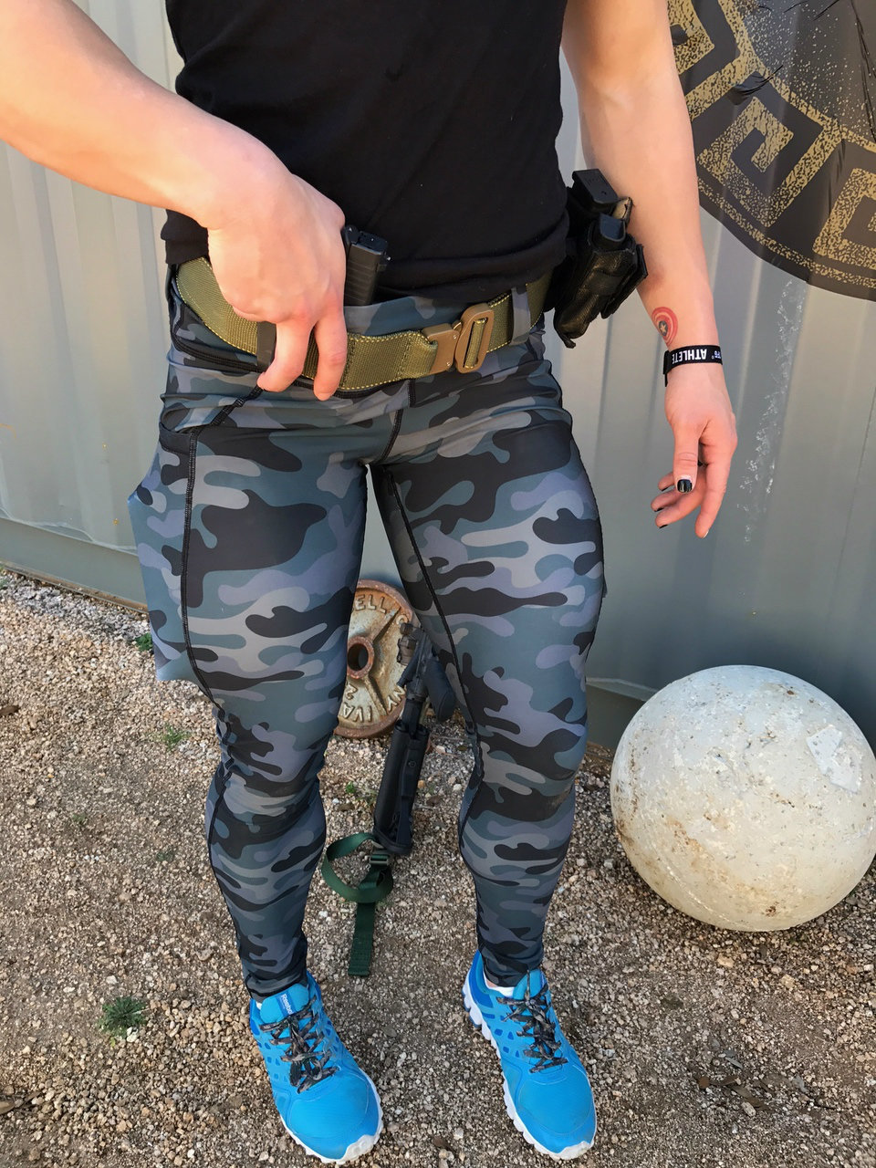 A model sports the Tactical Leggings in teal camo with her gun carried AIWB. (Photo: Rogue American Apparel)