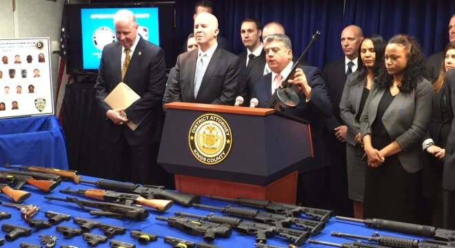 Acting Brooklyn District Attorney Eric Gonzalez, shown with a Thompson carbine, together with New York City Police Commissioner James P. O'Neill, announced the result of the gun bust Wednesday. (Photo: NYPD)