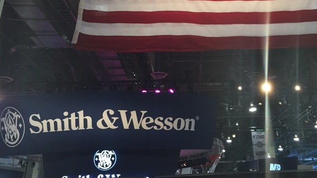 A Smith & Wesson sign below an American flag at SHOT Show 2017. (Photo: Daniel Terrill/Guns.com)