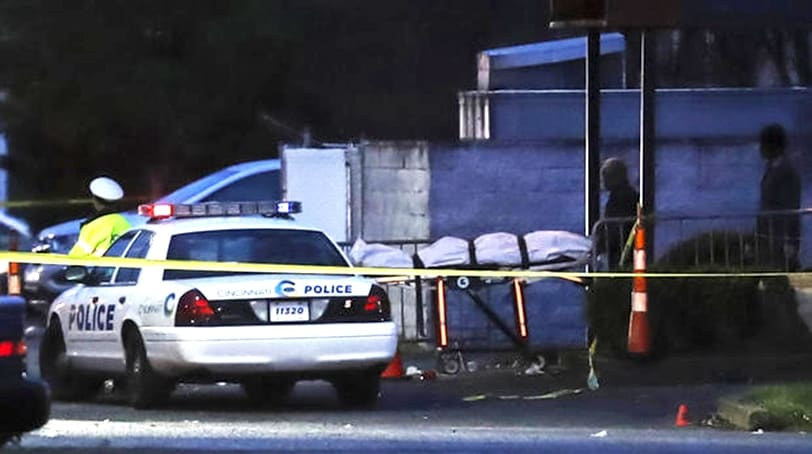 A body is removed as police operate at a crime scene outside the Cameo club after a fatal shooting, Sunday, March 26, 2017, in Cincinnati. (Photo: Associated Press)