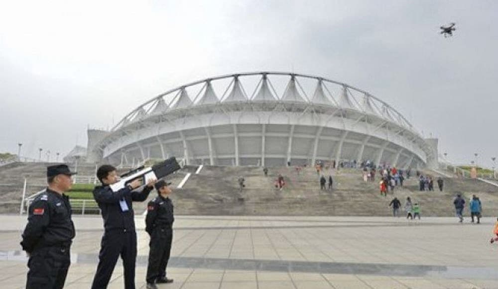 Chinese police test out an anti-drone gun near a soccer stadium in Wuhan. (Photo: Hubei Government via Popular Science)