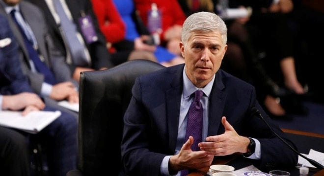 U.S. Appeals Court Judge Neil Gorsuch waded through 11 hours of committee hearings on Tuesday. (Photo: Joshua Roberts/Reuters)