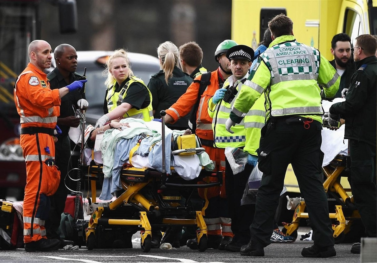 Emergency services care for a victim of the London attack near Westminster Bridge and Parliament (Photo: Getty Images)