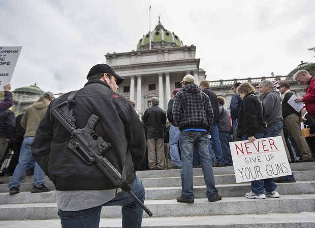 Christopher Kendra of York carries an AR-15 as he joins a large crowd gathered on the front steps of the Pennsylvania State Capitol Building for the Second Amendment Action Day in 2013 (Photo: Joe Hermitt/PennLive)