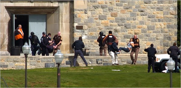 Emergency workers carried people from Norris Hall on the campus of Virginia Tech in Blacksburg, Va., on Monday after a gunman killed 32 people. (Photo: Alan Kim/The Roanoke Times, via Associated Press)