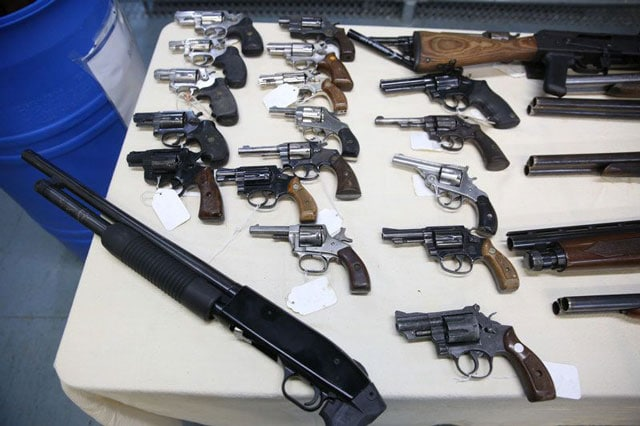 Newark confiscated handguns on table