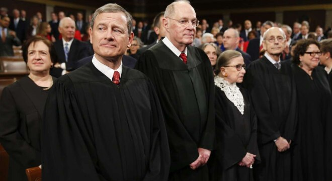 Chief Justice John Roberts and U.S. Supreme Court Justices Elena Kagan, Anthony Kennedy, Ruth Bader Ginsburg, Stephen Breyer and Sonia Sotomayor while attending President Barack Obama's State of the Union address in January 2016. (Photo: Evan Vucci/AP)