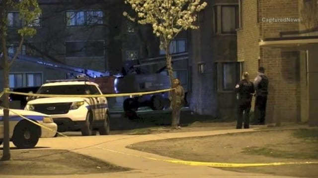 Chicago police work the scene of a fatal shooting in the Parkway Gardens neighborhood. (Photo: Captured News)