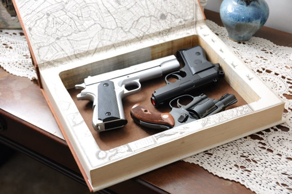 Though storing guns in unsecured books is ill-advised, the gun industry is stepping up to provide gun owners with to distribute guns around the home. (Photo: BookMods via Etsy)