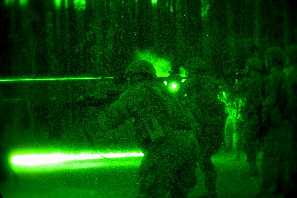 As seen through night-vision optics, scouts with the 82nd Airborne Division's 1st Brigade Combat Team practice using infrared during night fire training. (Photo: Sgt. Michael J. MacLeod, U.S. Army)