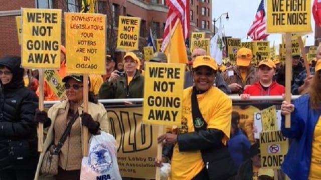 Gun rights activist Alreda Keith Keller marches in Springfiled, IL (Photo: Chicago Sun-Times)