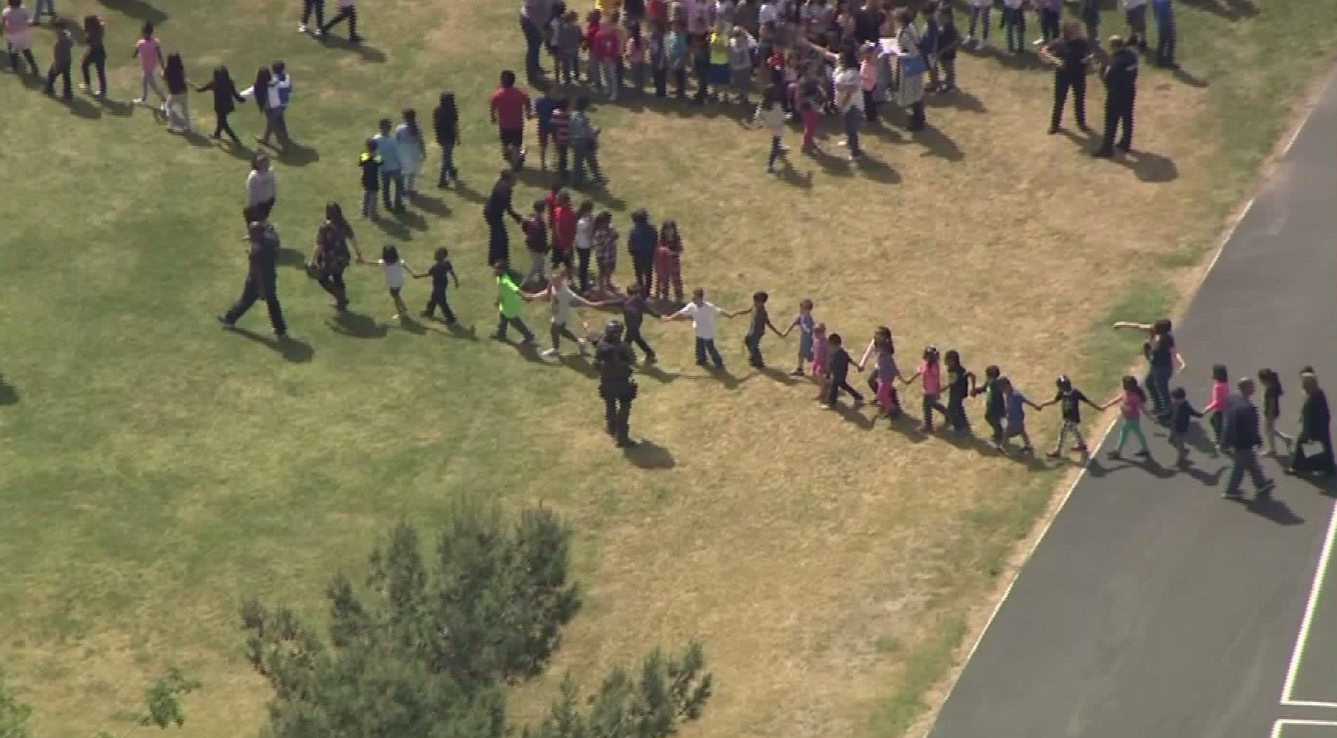 Students were evacuated from North Park Elementary School in San Bernardino on April 10, 2017 following a possible murder-suicide shooting on campus. (Credit: KTLA)